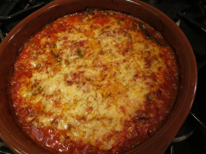 Baked vegetables casserole with chickpeas and grated cheese